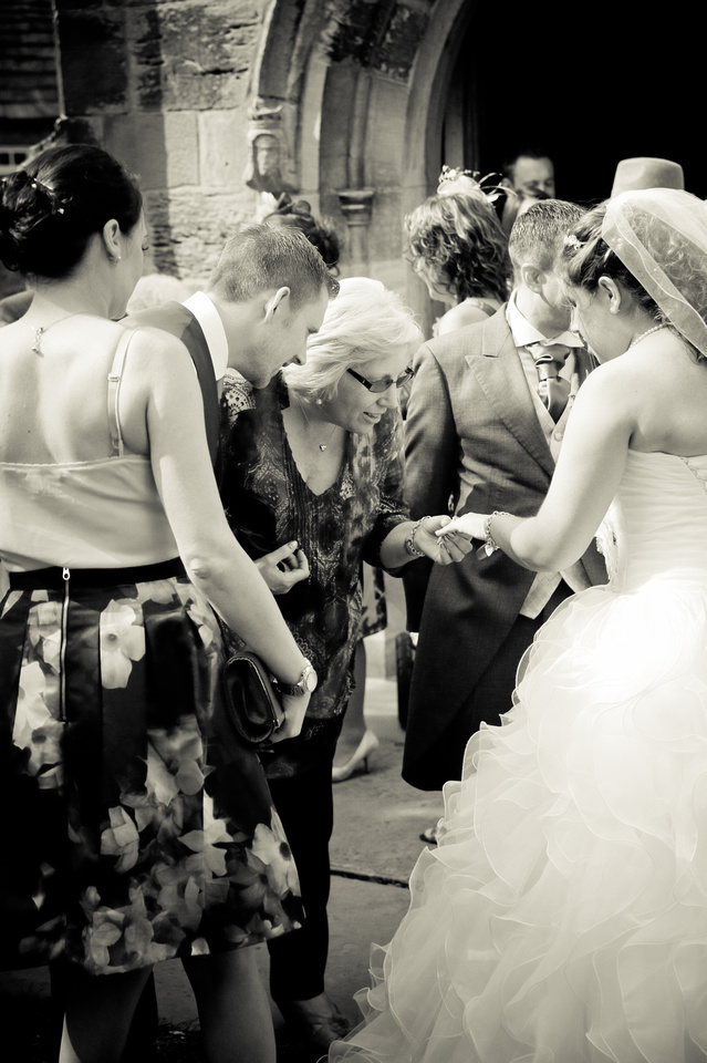 black and white wedding photo of bride outside south yorkshire church