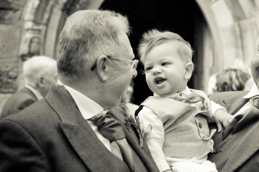 black and white image of pageboy at wedding outside church near Sheffield