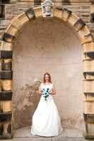 Ringwood hall bride in archway by wedding photographer Dan Mogan Photography