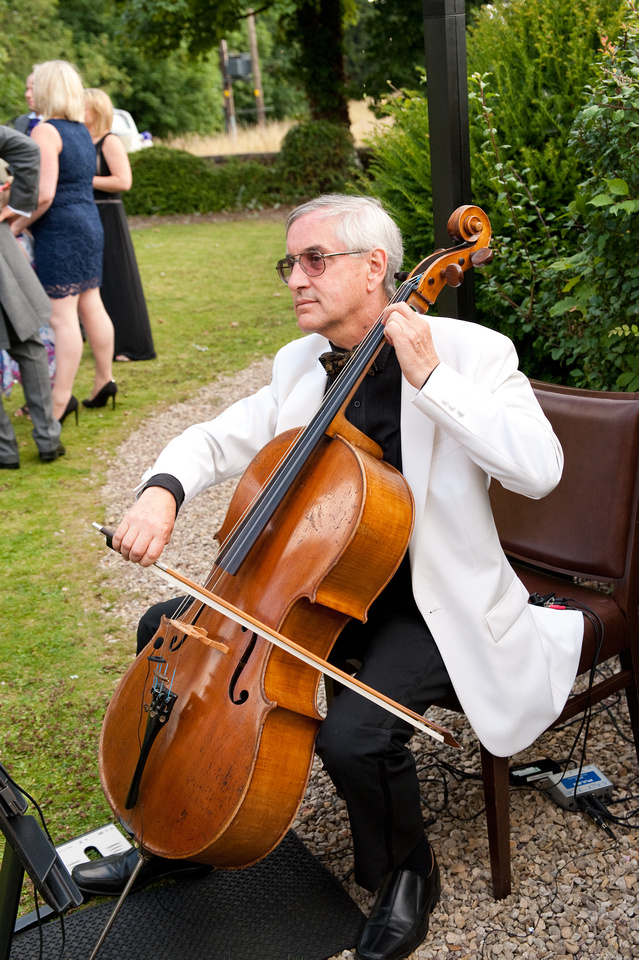 wedding photo of cellist playing at wedding in rotherham